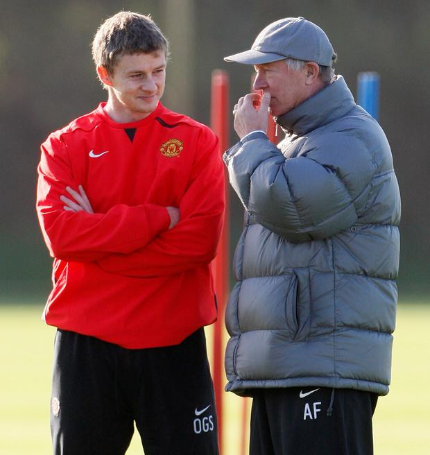 Manchester United interim boss Ole Gunnar Solskjaer with Alex Ferguson