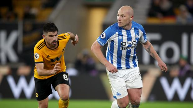 Injured Huddersfield midfilder Aaron Mooy, right, has been included in Australia's squad for the Asian Cup (Nick Potts/PA)
