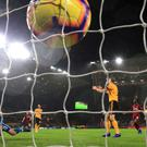 Liverpool's Mohamed Salah (far left) scores the opener at Wolves. (Nick Potts/PA)