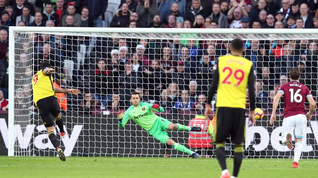 Troy Deeney's penalty set Watford on their way to victory over West Ham (Chris Radburn/PA).