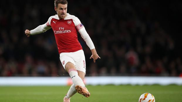 Arsenal's Aaron Ramsey is reportedly the subject of interest from PSG (Nick Potts/PA)