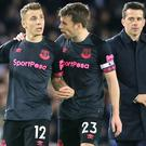 Lucas Digne, left, was unhappy following the final whistle at the Amex Stadium (Mark Kerton/PA)