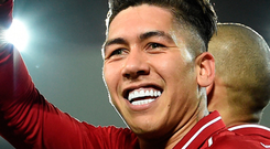 Brazilian forward Roberto Firmino celebrates scoring a penalty to complete his hat-trick in Liverpool's win over Arsenal at Anfield last night. Photo: Paul Ellis/Getty