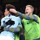 Manchester City's Leroy Sane (left) celebrates scoring his side's winner against Liverpool (Martin Rickett/PA)