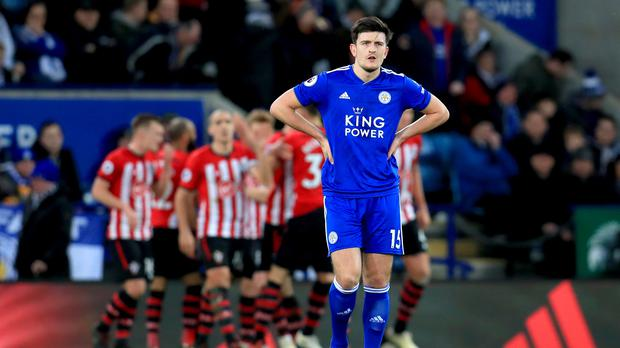 Harry Maguire is dejected after Shane Long's goal for Southampton. (Mike Egerton/PA)