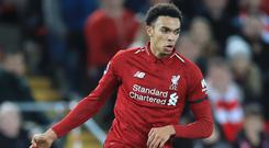 Liverpool defender Trent Alexander-Arnold could be out for a month with a knee injury (Peter Byrne/PA).