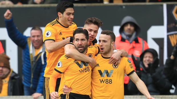 Diogo Jota (right) celebrates his first goal against Leicester on Saturday. (Mike Egerton/PA)
