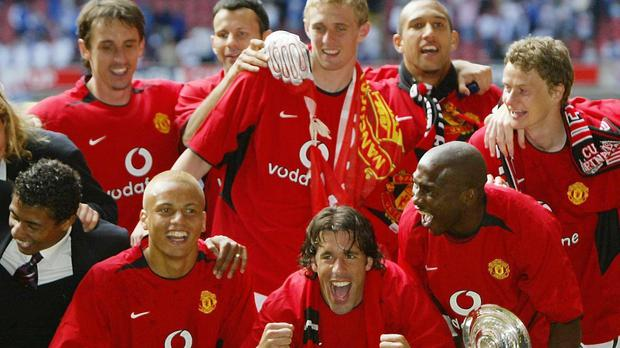 Tim Howard (back, second right) won the FA Cup alongside Ole Gunnar Solskjaer (right) (Martin Rickett/PA)
