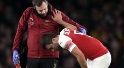 Arsenal's Sokratis Papastathopoulos (right) was injured against Manchester United on Friday (John Walton/PA)