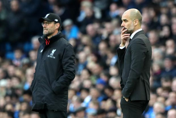 Jurgen Klopp (left) and Manchester City manager Pep Guardiola are embroiled in a title race (Martin Rickett/PA)