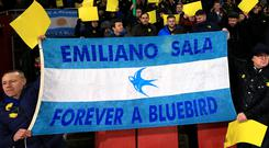 Cardiff City fans in the stands with a flag reading 'Emiliano Sala Forever a Bluebird' at the Emirates (Nick Potts/PA)