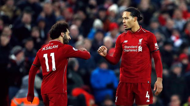 Liverpool lead the Premier League at the end of January (Darren Staples/PA)