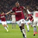 West Ham United's Michail Antonio celebrates scoring his side's first goal of the game during the Premier League match at the London Stadium.
