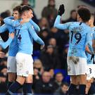 Aymeric Laporte, third left, celebrates City's opening goal (Peter Byrne/PA)