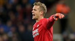 Jonas Lossl has not given up on Huddersfield's Premier League survival fight (Nigel French/PA)