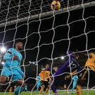 Wolves' Willy Boly heads in the late equaliser against Newcastle (Nick Potts/PA)