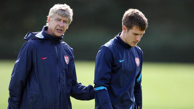 Arsene Wenger, left, believes the departure of Ramsey will be a big setback for Arsenal (Chris Radburn/PA)