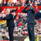 Ole Gunnar Solskjaer and Jurgen Klopp shared the points on Sunday (Martin Rickett/PA)