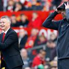 Jurgen Klopp, right, was satisfied with a point against Manchester United (Martin Rickett/PA)
