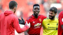 Paul Pogba could not find a way past Alisson Becker at Old Trafford (Martin Rickett/PA)