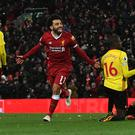 Liverpool's Mohamed Salah (centre) scored four times in a 5-0 win over Watford last season. (Anthony Devlin/PA)