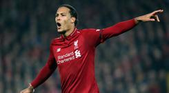 Virgil Van Dijk would be a worthy winner of the player of the year award, according to Liverpool team-mate Andy Robertson (Richard Sellers/PA)