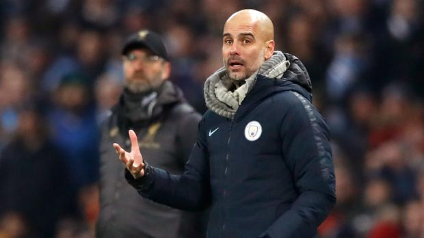 Manchester City manager Pep Guardiola will be out to keep his side ahead of title rivals Liverpool (Martin Rickett/PA Images)