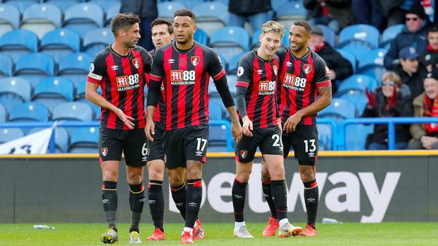 Bournemouth's Callum Wilson (right) celebrates his goal with team-mates (Richard Sellers/PA)