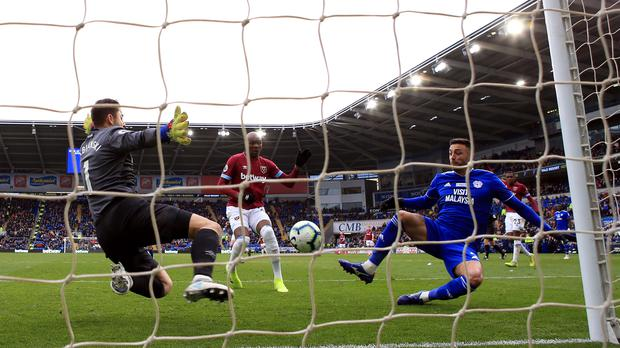Victor Camarasa scores Cardiff's second goal in their Premier League victory against West Ham (Nick Potts/PA)