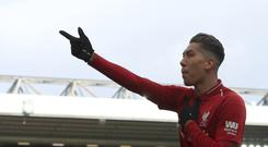 Liverpool's Roberto Firmino celebrates (Peter Byrne/PA)