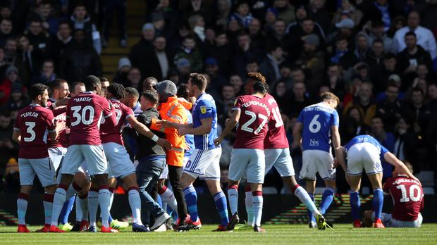 Jack Grealish (right) was punched by a pitch invader during Aston Villa's match at Birmingham (Nick Potts/PA)