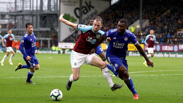 Wes Morgan, right, tussles with Ashley Barnes during Leicester's victory at Turf Moor (Martin Rickett/PA)