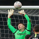 Millwall keeper David Martin lets Solly March's freekick slip through his fingers to give Brighton a last-gasp equaliser