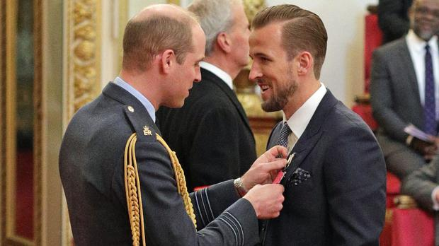Harry Kane received his MBE from Prince William (Yui Mok/PA)
