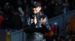 Liverpool manager Jurgen Klopp is confident his players will thrive in the title run-in (Peter Byrne/PA)