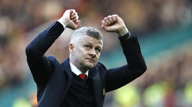Ole Gunnar Solskjaer salutes the Old Trafford crowd after the win over Watford (Martin Rickett/PA)