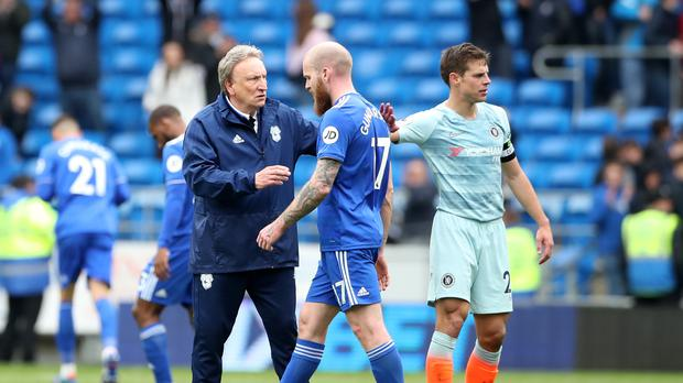 Cardiff manager Neil Warnock, left, and Aron Gunnarsson after the defeat to Chelsea (Nick Potts/PA)