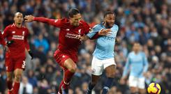 Virgil Van Dijk, left, has gone for Manchester City's Raheem Sterling in the PFA Player of the Year voting (Martin Rickett/PA)