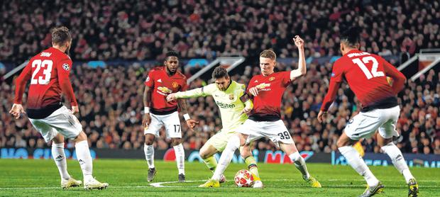 Centre of attention: Four Manchester United players keep their eyes on Lionel Messi at Old Trafford last night. Photo: Reuters