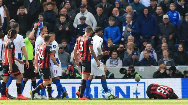 Brighton's Anthony Knockaert is sent off for a bad foul on Bournemouth's Adam Smith (Gareth Fuller/PA).