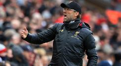 Liverpool manager Jurgen Klopp has set his sights on a club-record points haul in their close title race with Manchester City (Peter Byrne/PA)