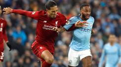 Virgil Van Dijk, left, and Raheem Sterling are the front-runners for the Professional Footballers' Association Player of the Year award (Martin Rickett/PA)