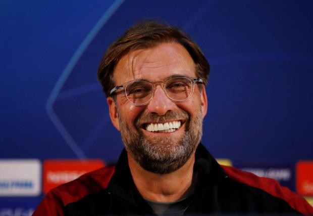 Jurgen Klopp: 'We want to be playing and winning, not sitting at home and hoping the others lose'. Photo: Reuters/Andrew Boyers