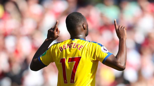 Crystal Palace's Christian Benteke celebrates scoring his side's first goal of the game during the Premier League match at The Emirates Stadium, London.