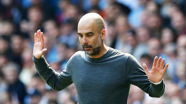 Manchester City manager Pep Guardiola has hit back at suggestions he condones 'tactical fouling' (Martin Rickett/PA).