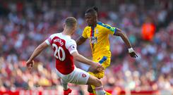 Arsenal's Shkodran Mustafi, left, was put under pressure by Crystal Palace's Wilfried Zaha (Bradley Collyer/PA)