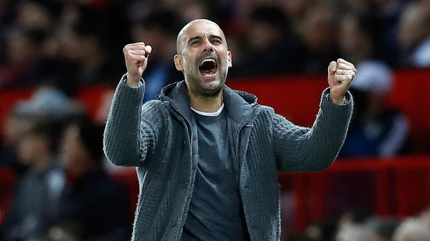 Pep Guardiola's Manchester City moved closer to the title with a crucial derby win over Manchester United (Martin Rickett/PA)