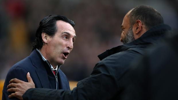 Unai Emery and Nuno Espirito Santo embrace at Molineux (Nick Potts/PA)