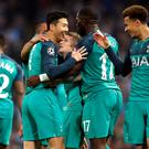 Son Heung-min, left, trusts his team-mates to cope against Ajax in his absence (Martin Rickett/PA)
