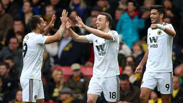 Diogo Jota (centre) celebrates his winner for Wolves (Nigel French/PA)
